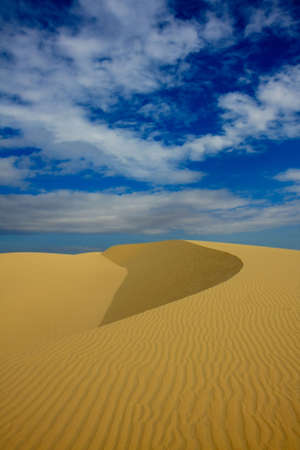A sand dune under a blue sky in Vietnam