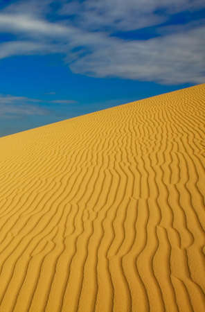 A sand dune with fascinating pattern under the hot Vietnam sun.