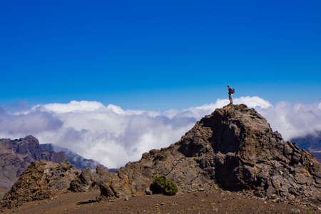 A hiker is enjoying a breathtaking view of the Haleakala Crater - Haleakala Volcano National Park - Maui, Hawaii 版權商用圖片