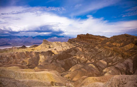 A scenic view of eroded rock formation in desolated Death Valley. USA, California