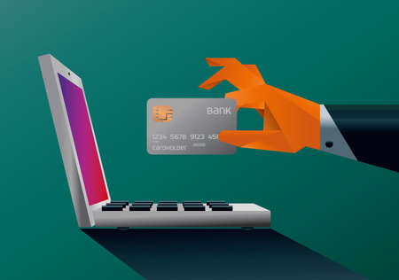 illustration of a hand holding a credit card in front of a laptop screen. Concept of paying or buying  overthe internet