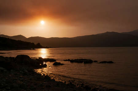 The photo was taken at the location of Buško Lake. The fog that hides the sun is actually thick smoke created by a nearby fire that raged the surrounding area.