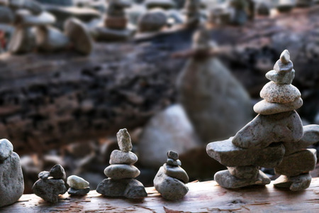 Row of cairns along the beach in Vancouver, Canada