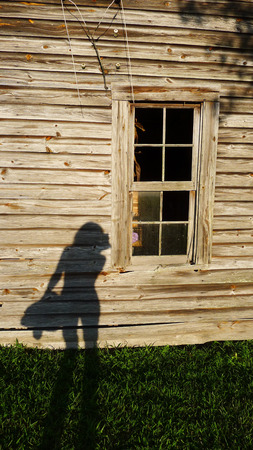 woman shadow: Shadow of a shapely woman on a cabin wall Stock Photo