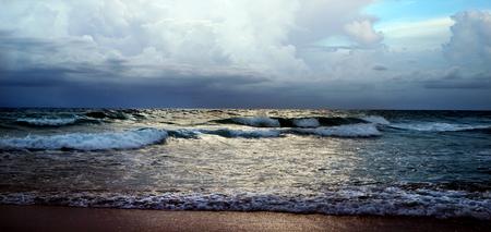 waters edge: Ocean Waves Under Dark sky, Glow On Water to waters edge on beach sand