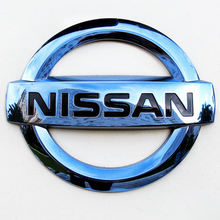 Stock Photo   West Palm Beach, Florida ,September 18, 2016 , Close Up Of  Nissan Emblem With Sky Reflection On A White Nissan Electric Car Displayed  At The ...