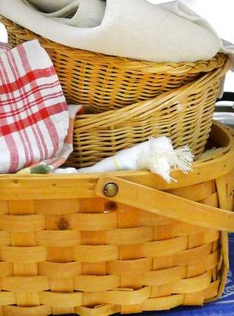 felice: Group of 3 country wicker woven baskets with checkered towel and other woven towels.
