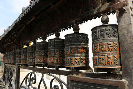 Traditionally, the mantra Om Mani Padme Hum is written in Newari language of Nepal, on the outside of the wheel. 스톡 콘텐츠