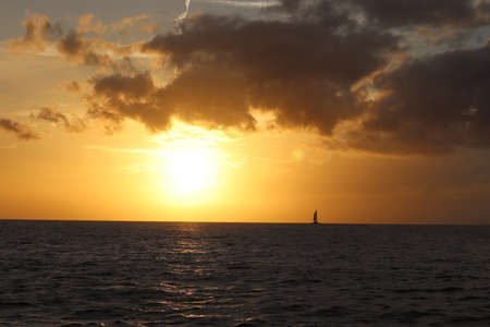Sailing ship at sunset in Hawaii 스톡 콘텐츠