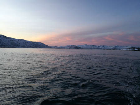 Norway to see snow-capped mountains from the sea near tromso