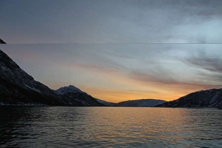 in the fjords of Norway at sunset 스톡 콘텐츠