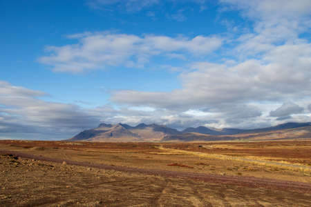 rough landscape in Iceland in fine weather, blue sky, mountains, autumn colors 스톡 콘텐츠