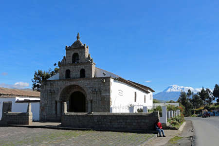 Church with the volcano Chimborazo in the background in Ecuador travel Stock Photo