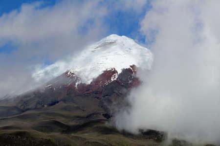 Volcano Cotopaxi between clouds in Ecuador