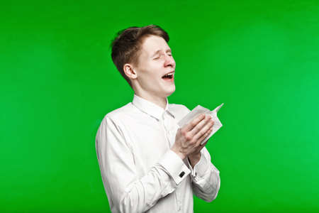 running nose: young man sneezing and running nose on chroma key background Stock Photo