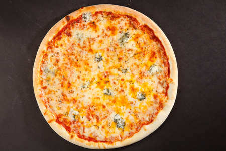 pizzas: Top view tasty italian pizza on dark background