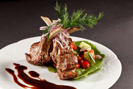 roast lamb: rack of lamb with vegetables and sauce