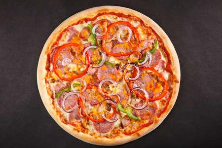 Top view tasty italian pizza on dark background