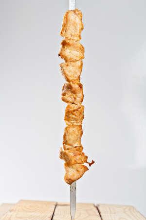 hot roasted meat shish kebab on metal skewer