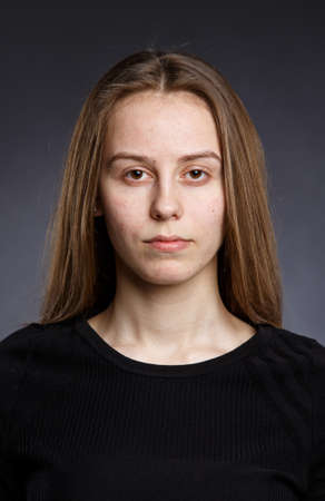 without: Clean face of young girl no makeup studio portrait