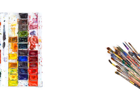 paintbox: Used water-color paint-box and paint brush. Top view. Isolated image Stock Photo
