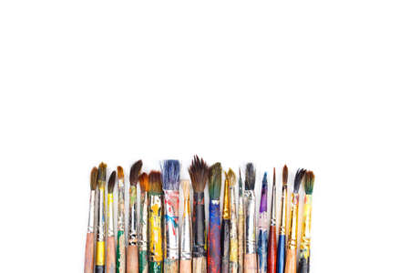 artist: Big set of artist dirty paint brushes on white background with much space for text. Isolated image.