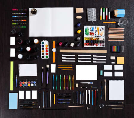 painter: large set of different stationery of artist painter or student. Real photo. pencils, pens, notepads an other Stock Photo
