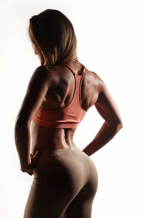 sex activity: Beautiful young athletic girl, with sport body wet, sexual booty on a white studio background