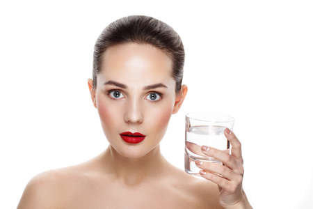 still water: Beauty portrait of pretty girl with natural makeup and Glass of Still Water. Commercial photo for promotion health. Youth and skin care concept. Still water drinking