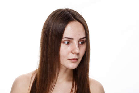 NO MAKEUP Natural Clean Face of Young Brunette Girl Without No makeup. Studio Portrait White Isolated