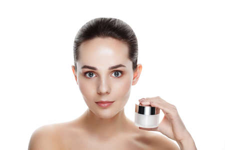 Beauty portrait of pretty girl with natural makeup hold face cream. Commercial photo for promotion cosmetic. Youth and skin care concept. Anti-age, day, night cream for young skin