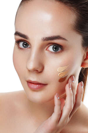 Beauty Girl Try to Different tones of Foundation Concealer. Natural Makeup for Brunette Woman with  Beautiful Face. Makeover. Perfect Skin. Applying Make-up. Ideal for commercial