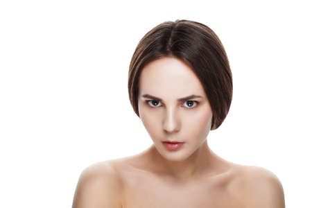 dissatisfaction: Beautiful face of young dissatisfaction girl with clean fresh skin. Portrait woman with beautiful blue eyes and face on white background. Beautiful woman purity face with natural make-up. Cute model with shiny skin
