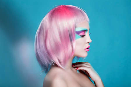 Great Profile of Sexy Girl with Creative Face Art Trendy Makeup and Pink Hairs. Trendy advertisement of sale and shopping Reklamní fotografie