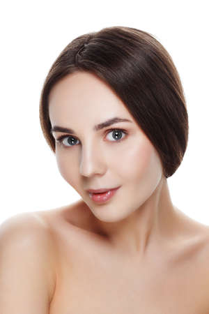 Beautiful face of young woman with clean fresh skin. Portrait woman with beautiful blue eyes and face on white background. Beautiful woman purity face with natural make-up. Cute model with shiny skin Фото со стока