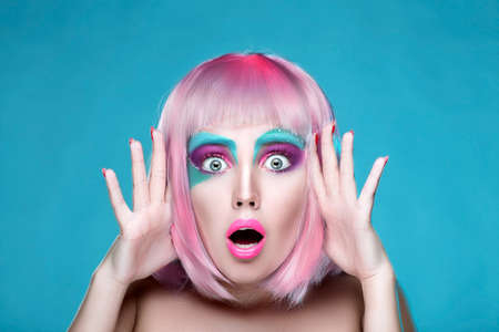 Shocked and Surprised Sexy Girl with Creative Makeup and Pink Hairs. Trendy advertisement of sale and shopping Фото со стока