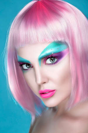 Closeup Portrait of sexy woman with creative makeup and rose quartz hairs on serenity background