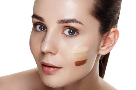 concealer: Beauty Girl Try to Different tones of Foundation Concealer. Natural Makeup for Brunette Woman with  Beautiful Face. Makeover. Perfect Skin. Applying Make-up. Ideal for commercial
