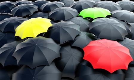 Three colorful umbrellas among black