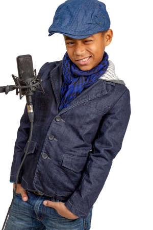 mulatto: Beautiful mulatto boy posing near the microphone. Stock Photo