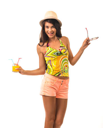 minx: Charming girl is holding the glass with two juice tubes. Pretty lady in the straw hat. Stock Photo