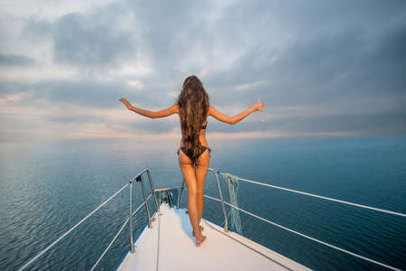 Girl resting on the sea. Relax on a yacht. Yacht in the open sea. Traveling on a yacht.