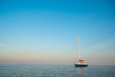 Sea voyage on a sailing yacht. Calm on the sea. Walk on a yacht on the ocean. Cruise on a yacht. Young people is resting on the sailing yacht. Sailing yacht at sea. Yachting.