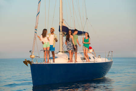 yacht club: People on the yacht. Corporate party on a yacht. Merry Company is resting on a yacht. Young guys and girls are sailing on a yacht. Yacht voyage.