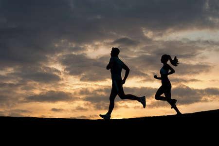 scamper: Morning running. Running athletes. Silhouette of runner on evening scamper.