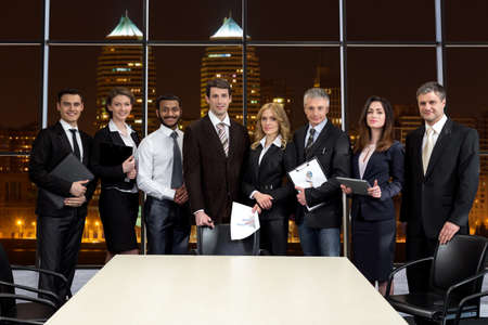 Delegation: Business people on the background of skyscrapers. Business office in a skyscraper. Business delegation. Stock Photo