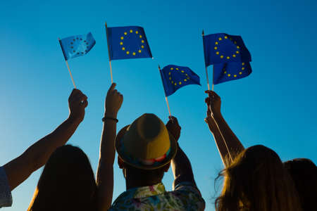 European fans on football. Pop stars in Europe. Crowd at Eurovision. Young people holding flags of the European Union. People want to Europe.