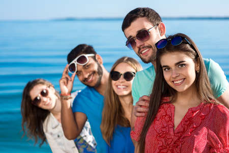 vacation: Friends spend a weekend at sea. Beautiful youth smiling. Vacations on the sea. Students are on vacation. Happy people.