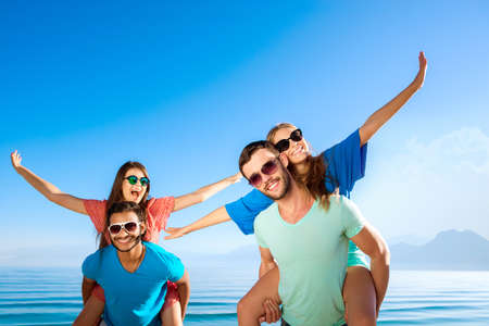 tour operator: Tour by island. Tour operator. Ticket to the rest. Happy guys and girls at resort. Cheerful young people relaxing on the Mediterranean. Stock Photo