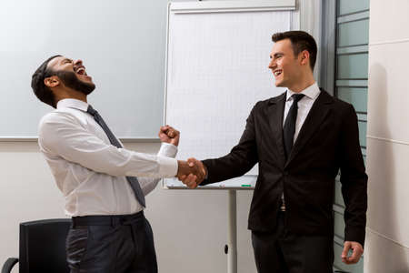 clerks: Clerks pleased the business transaction. Success of two partners. Stock Photo